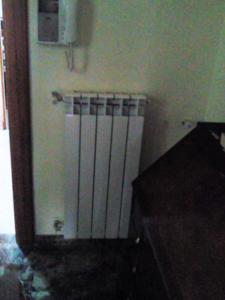 1-impianti-termici-progetto-1-istallazione-radiatori-dopo-realizzazione-impi (2)