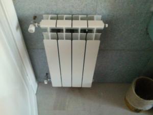 1-impianti-termici-progetto-1-istallazione-radiatori-dopo-realizzazione-impi (3)