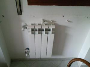 1-impianti-termici-progetto-1-istallazione-radiatori-dopo-realizzazione-impi (5)